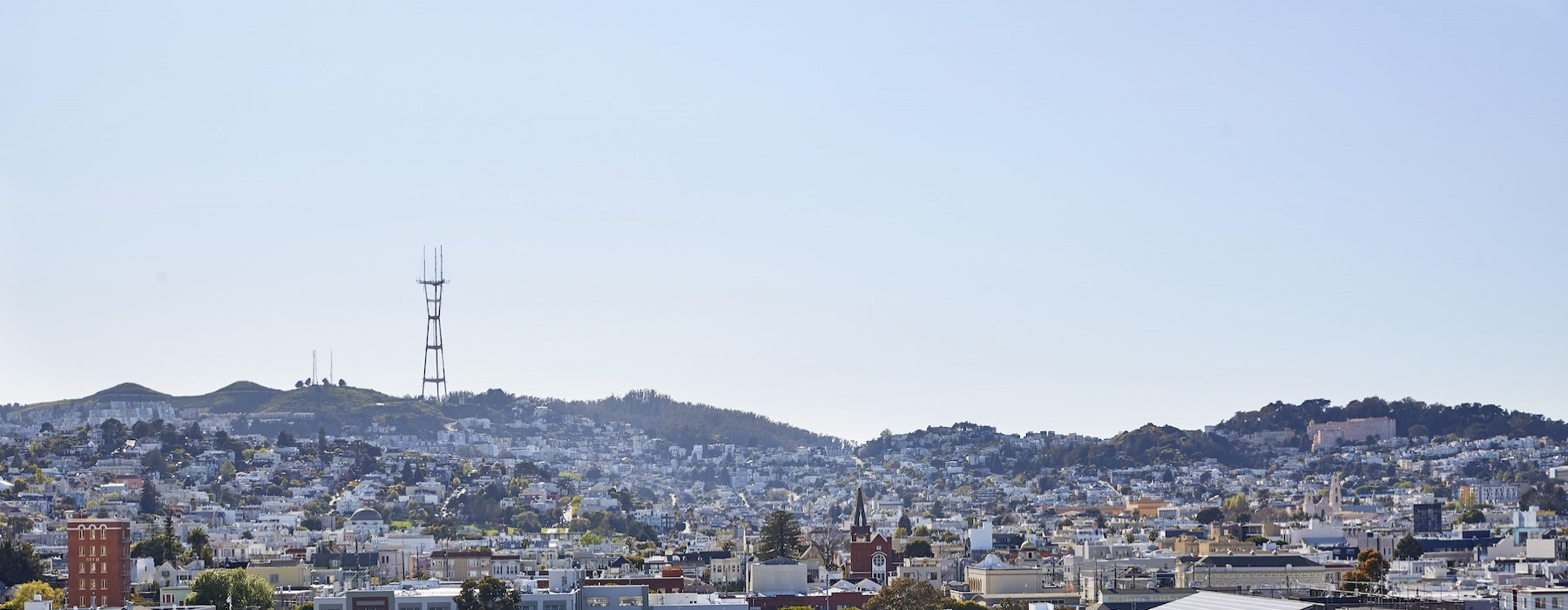 Skyline views of The Mission and Castro District with Sutro Tower in the distance